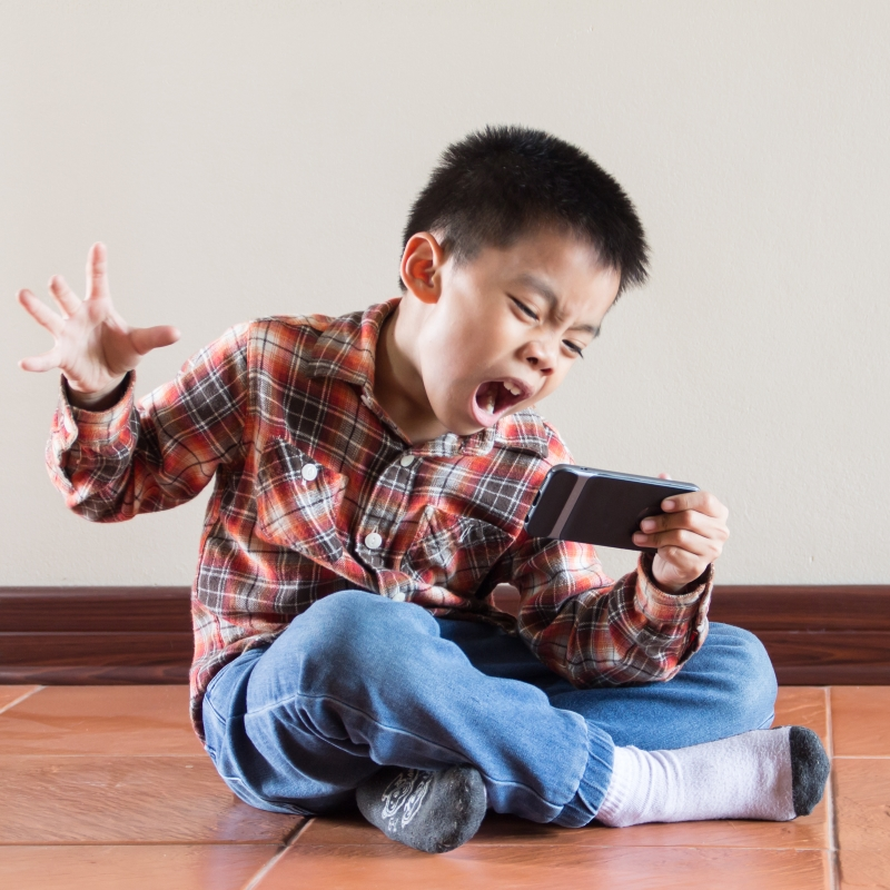 Young boy and smartphone