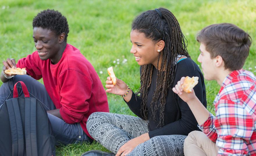 children sat in field