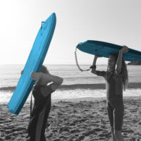 boy and girl with surfboards